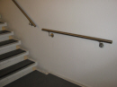 Trappegelænder, rækværk: Håndliste i rustfrit stål.